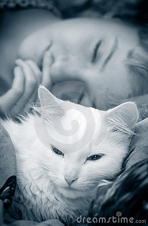 Girl sleeps with cat