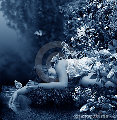 Girl sleeps beside creek