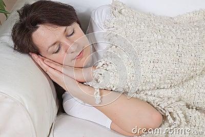 Girl sleeps on a soft divan