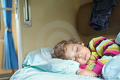 Girl sleeps in train