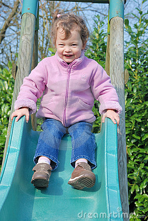 Girl On Slide Royalty Free Stock Photo - Image: 19259105