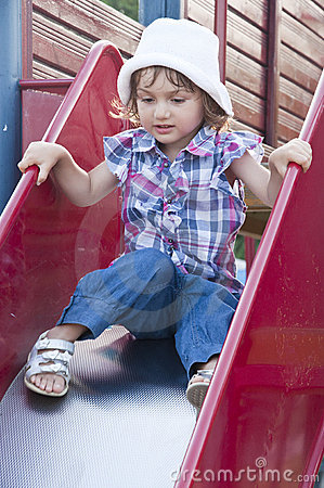 Girl on slide at playground