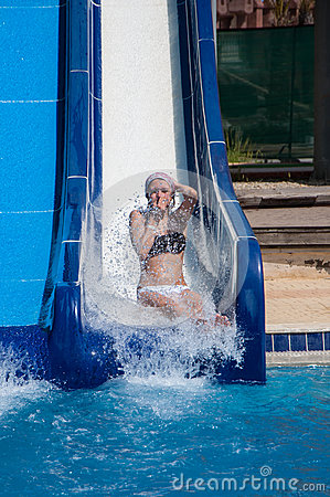 Free Girl Sliding Down Water Slides Royalty Free Stock Images - 73323829
