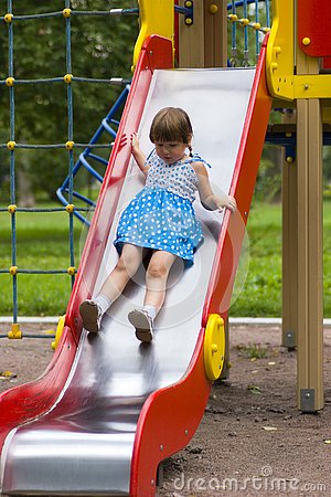Girl sliding on playground