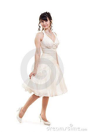 A girl in a smart white dress