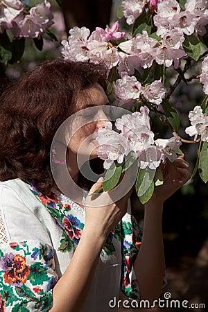 Girl smell a flower