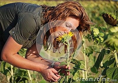 Girl smell sunflower 2