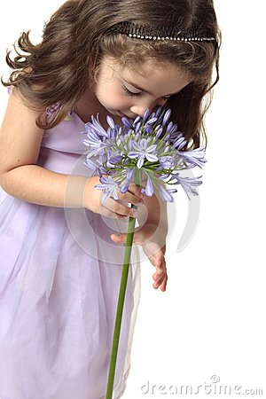 Girl Smelling A Beautiful Flower Stock Photos - Image: 8417343