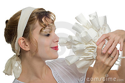Girl smelling at a bouquet of white paper roses