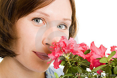 Girl smelling a flower.