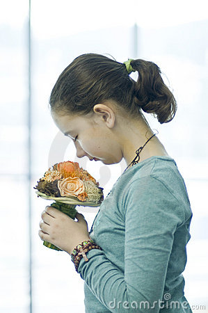 Free Girl Smelling Flower Bouquet Stock Photography - 4902002