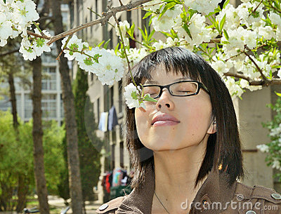 Girl smelling the flowers