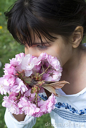 Girl smelling pink flowers