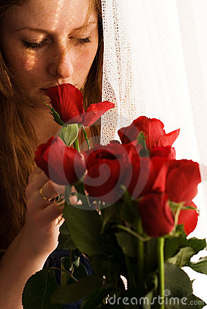 Girl smelling red roses
