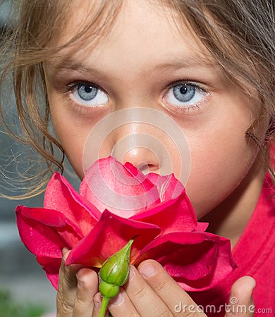 Girl smelling  rose