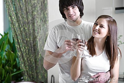 Girl with smile and boy with wineglasses