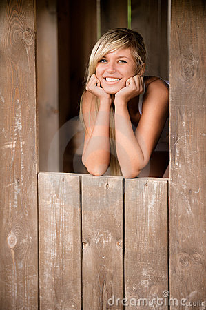 Free Girl Smiles From Shed Royalty Free Stock Images - 14352319