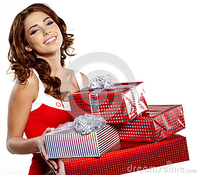 Girl smiles and holding a gift in magic packing