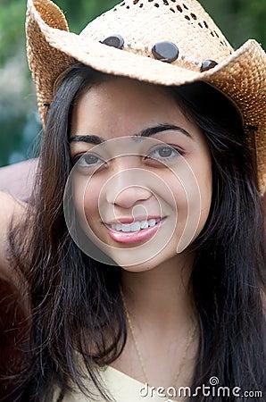 Girl smiling in Cowboy hat