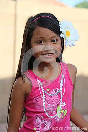 Girl Smiling With Flower In Hair
