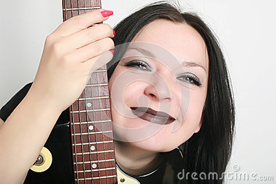 Girl smiling with guitar isolated