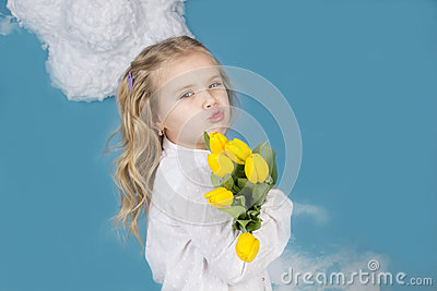 Girl smiling and holding a bouquet of flowers