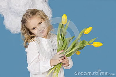 Girl smiling and holding a bouquet of tulips