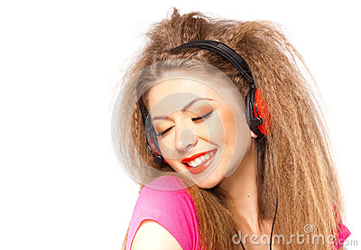 Girl smiling while listening music on headphones