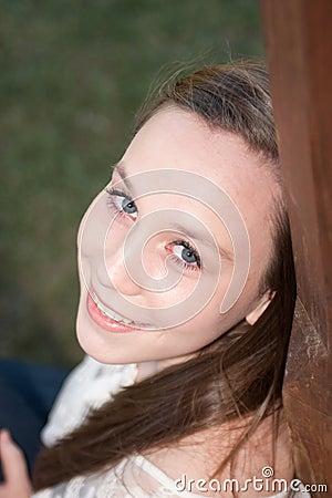 Girl smiling over her shoulder