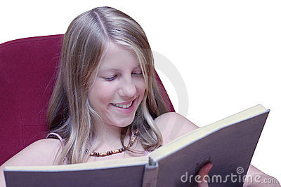 Girl smiling when reading book