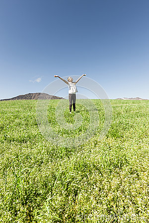 Girl smiling into the sky