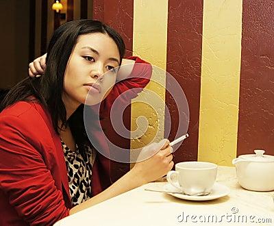 Girl smokes a cigaret
