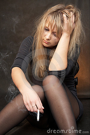 Girl is smoking in depression and frustration...
