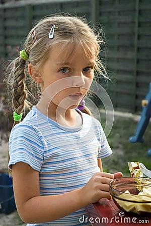 Girl sneaking chocolate.