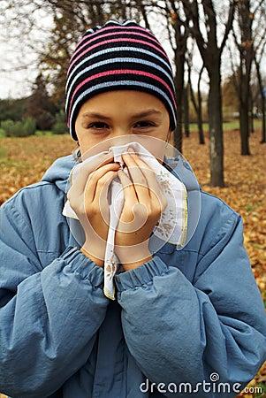 Girl sneasing in handkerchief