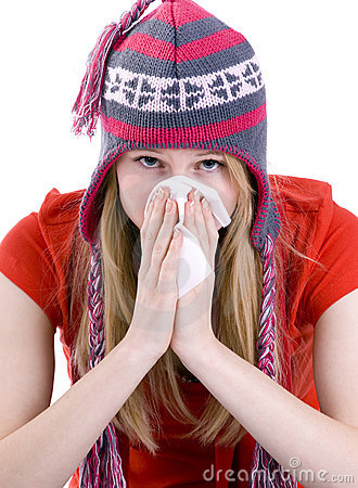 Girl sneezing to paper handkerchief in winter cap
