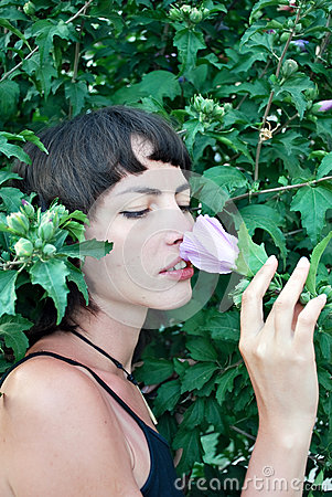 Girl sniffs a flower