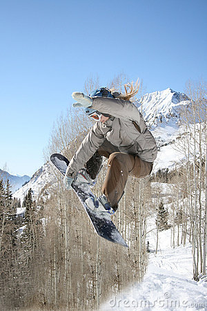 girl snow boarder hits jump