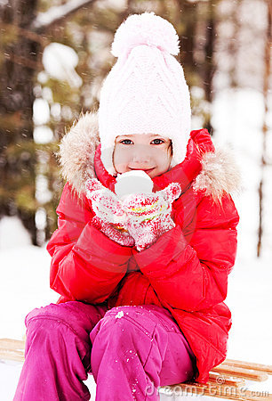 Girl with a snowball