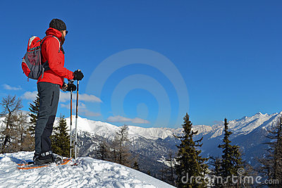 Girl with snowshoes