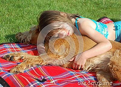 Girl snuggle a Dog