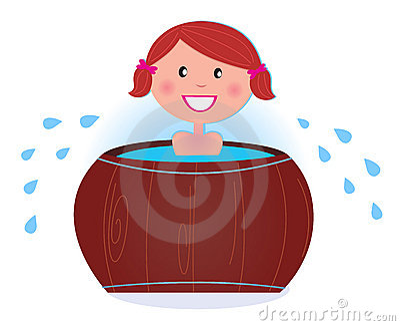 A girl soaking in cold barrel tub after sauna