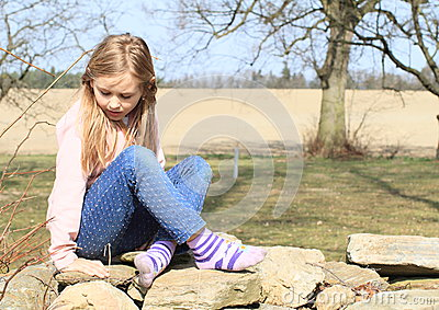 Girl in socks on wall
