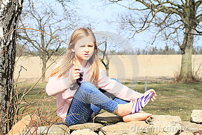 Girl in socks on wall