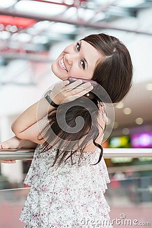 Girl speaks by phone