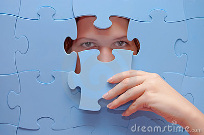 Girl spies through a blue puzzle