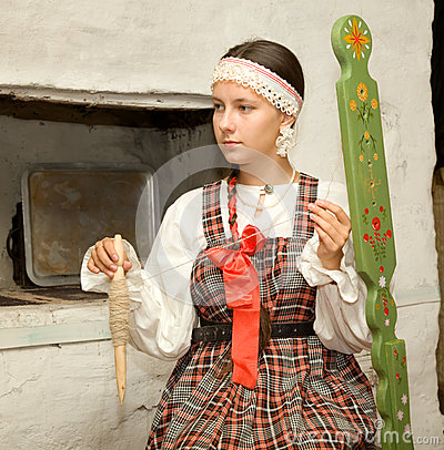 Girl spins a yarn of wool