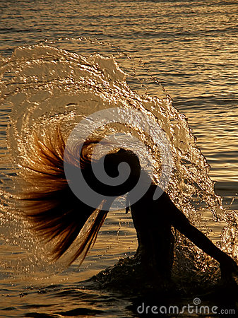 Free Girl Splashing The Sea Water Royalty Free Stock Photography - 25196107