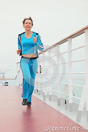 Girl in sport dress running on cruise liner deck