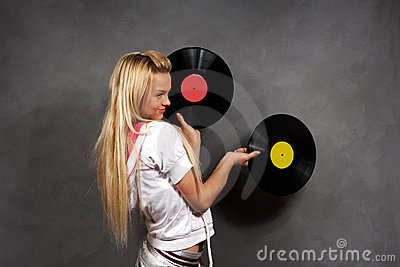 Girl in sports clothes with vinyl